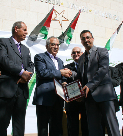 Mr. Simon Awad (right) and PA Prime Minister Dr. Salam Fayyad at the opening of the 11th Annual Olive Harvest Festival in Bethelhem.