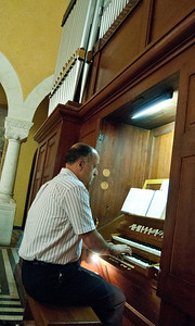 Ghassan, the organist for the Arabic-congregation of the Evangelical Lutheran Church of the Redeemer accompanying worship.  Photo © ELCJHL/Rev. Elizabeth McHan
